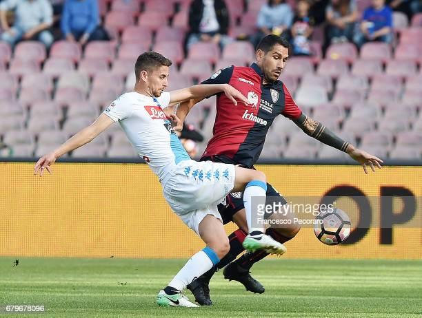 Player of SSC Napoli Jorginho vies with Cagliari Calcio player Marco Borriello during the Serie A match between SSC Napoli and Cagliari Calcio at...