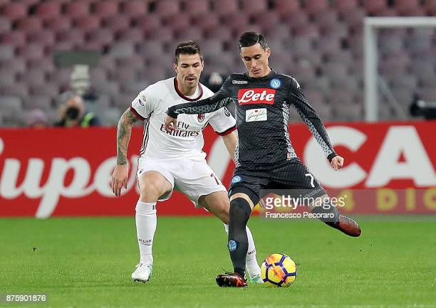 Player of SSC Napoli Jose Calleon vies with AC Milan player Alessio Romagnoli during the Serie A match between SSC Napoli and AC Milan at Stadio San...