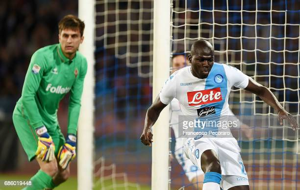 Player of SSC Napoli Kalidou Koulibaly celebrates after scoring the 10 goal beside the disappointment of Ciprian Tatarusanu player of ACF Fiorentina...