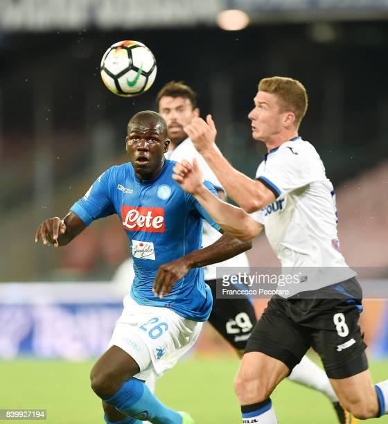 Player of SSC Napoli Kalidou Koulibaly vies with Atalanta BC player Robin Gosens during the Serie A match between SSC Napoli and Atalanta BC at...