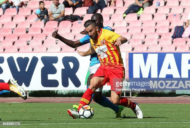 Player of SSC Napoli Kalidou Koulibaly vies with Benevento Calcio player Massimo Coda during the Serie A match between SSC Napoli and Benevento...