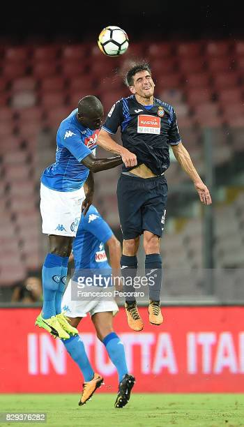 Player of SSC Napoli Kalidou Koulibaly vies with Espanyol player Gerard Moreno during the preseason friendly match between SSC Napoli and Espanyol at...
