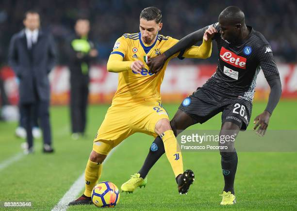 Player of SSC Napoli Kalidou Koulibaly vies with Juventus player Mattia De Sciglio during the Serie A match between SSC Napoli and Juventus at Stadio...