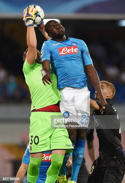 Player of SSC Napoli Kalidou Koulibaly vies with OGC Nice player Yoan Cardinale during the UEFA Champions League Qualifying PlayOffs Round First Leg...