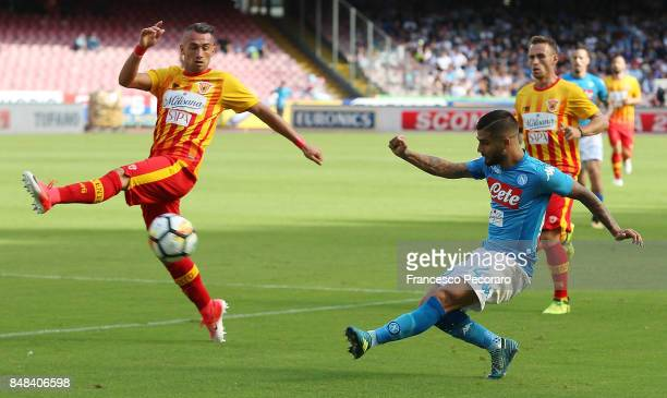 Player of SSC Napoli Lorenzo Insigne vies with Benevento Calcio player Gaetano Letizia during the Serie A match between SSC Napoli and Benevento...