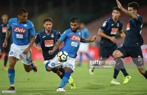 Player of SSC Napoli Lorenzo Insigne vies with Espanyol players during the preseason friendly match between SSC Napoli and Espanyol at Stadio San...