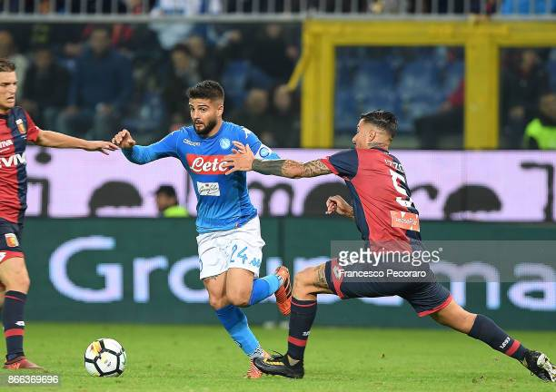Player of SSC Napoli Lorenzo Insigne vies with Genoa CFC player Armando Izzo during the Serie A match between Genoa CFC and SSC Napoli at Stadio...