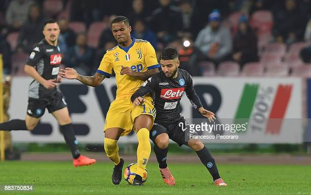 Player of SSC Napoli Lorenzo Insigne vies with Juventus player Douglas Costa during the Serie A match between SSC Napoli and Juventus at Stadio San...
