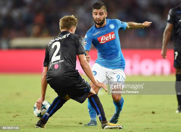 Player of SSC Napoli Lorenzo Insigne vies with OGC Nice player Arnaud Souquet during the UEFA Champions League Qualifying PlayOffs Round First Leg...