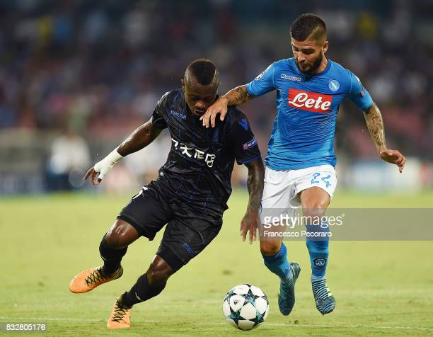 Player of SSC Napoli Lorenzo Insigne vies with OGC Nice player Jean Seri during the UEFA Champions League Qualifying PlayOffs Round First Leg match...