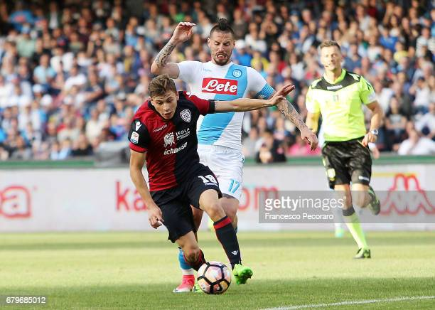 Player of SSC Napoli Marek Hamsik vies with Cagliari Calcio player Nicolò Barella during the Serie A match between SSC Napoli and Cagliari Calcio at...
