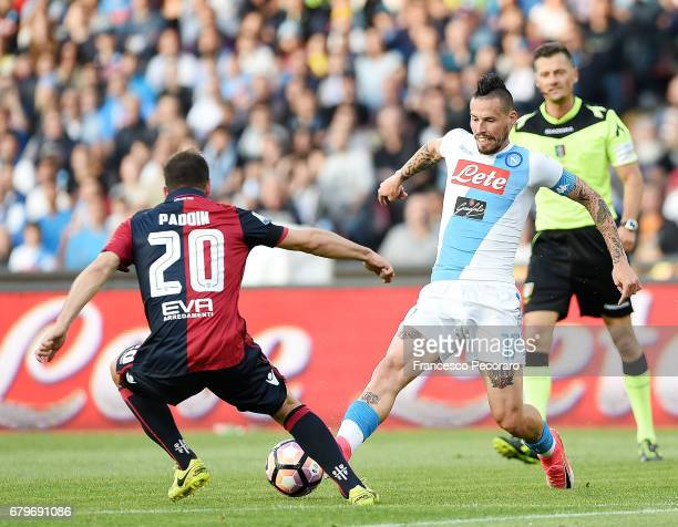 Player of SSC Napoli Marek Hamsik vies with Cagliari Calcio player Simone Padoin during the Serie A match between SSC Napoli and Cagliari Calcio at...