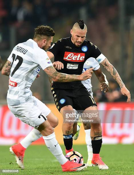 Player of SSC Napoli Marek Hamsik vies with Udinese Calcio player Cyril Thereau during the Serie A match between SSC Napoli and Udinese Calcio at...