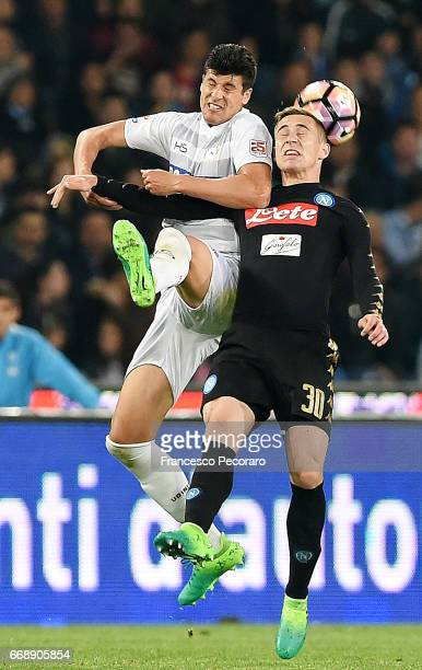 Player of SSC Napoli Marko Rog vies with Udinese Calcio player Stipe Perica during the Serie A match between SSC Napoli and Udinese Calcio at Stadio...