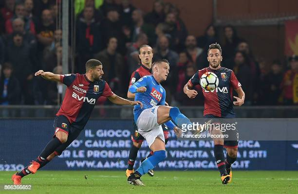 Player of SSC Napoli Piotr Zielinski vies with Genoa CFC players Adel Taarabt and Andrea Bertolacci during the Serie A match between Genoa CFC and...