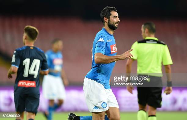 Player of SSC Napoli Raul Albiol celebrates after scoring the 20 goal beside the disappointment of player of Espanyol during the preseason friendly...