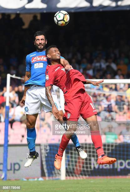 Player of SSC Napoli Raul Albiol vies with Cagliari Calcio player Joao Pedro during the Serie A match between SSC Napoli and Cagliari Calcio at...