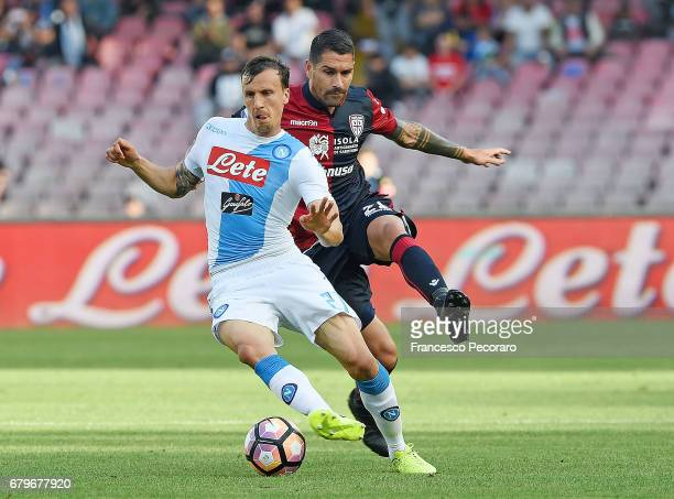 Player of SSC Napoli Vlad Chiriches vies with Cagliari Calcio player Marco Borriello during the Serie A match between SSC Napoli and Cagliari Calcio...