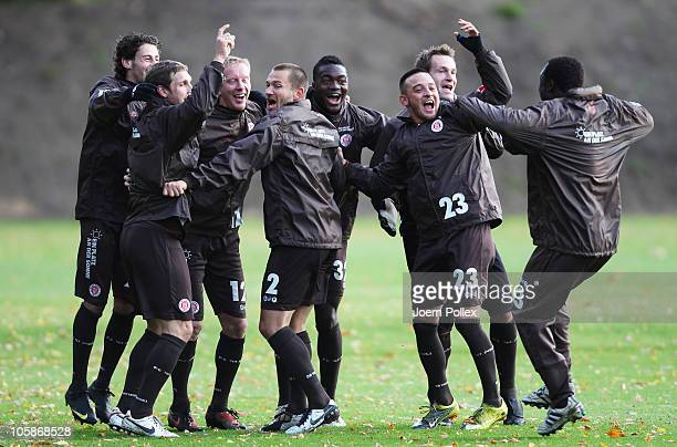 Player of St Pauli celebrate during the training session of FC StPauli at the team's training ground on October 21 2010 in Hamburg Germany