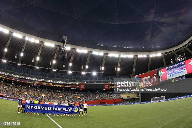 Player of team Germany and team France along with referees poses with a fair play banner prior to the FIFA Women's World Cup Canada 2015 quarter...