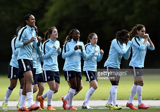 Player of the French national women's football team warm up during a training session in ClairefontaineenYvelines Suburban Paris on May 13 2015 as...