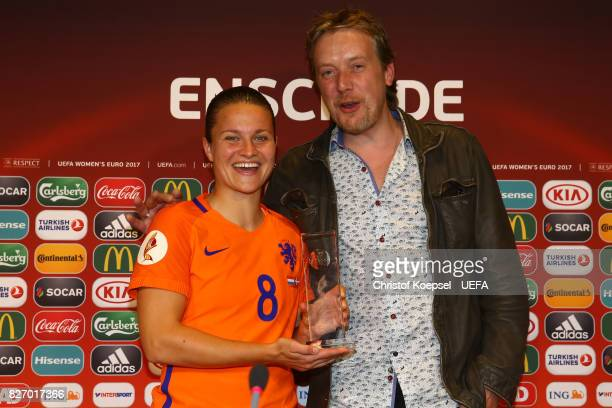 Player of the match Carlsberg award to Sherida Spitse of the Netherlands who poses with Bart Hunnink of Carlberg after the Netherlands v Denmark UEFA...