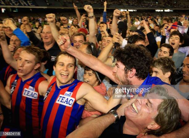 Player of the match Troy Pinwill of Port Melbourne celebrates with coach Gary Ayres after the VFL Grand Final match between Port Melbourne and...