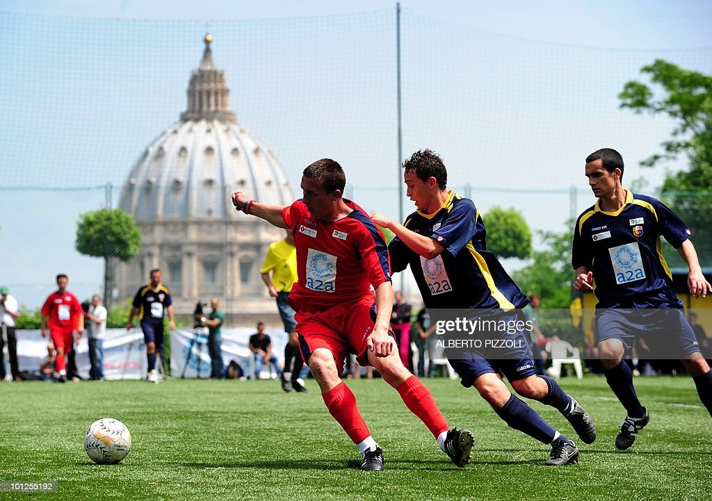 A player of the North American Martyrs (C) fights for the ball with players of the Redemptoris Mater during the finale in the soccer final of the fourth Clericus Cup on May 29, 2010 at the Pontificio Oratorio San Pietro in Rome, near The Vatican. The Clericus Cup, is the football championship organized by the Vatican at the Italian sporting Center (CSI), a sport organization of the Catholic Church.