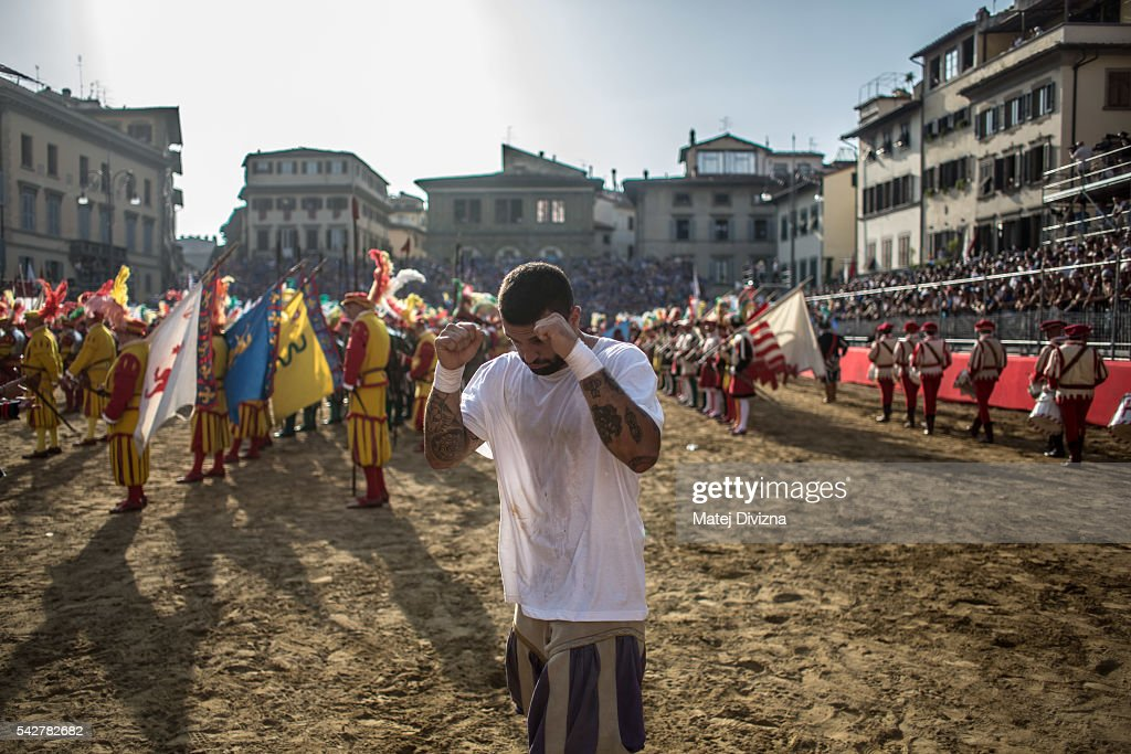 A player of the Santo Spirito Bianchi Team prepare before the final match of The Calcio Storico Fiorentino between the Santo Spirito Bianchi (White) Team and the La Santa Croce Azzuri (Blue) Team at the La Santa Croce square on June 24, 2016 in Florence, Italy. The Calcio Storico (Historical Football in English) Fiorentino is an early form of football, originating in the 1500's. It is a combination of football, rugby and wrestling. Now, annually during a weekend in early June, four teams representing the districts of Florence face each other in the first semi-finals. The winners go to the final, played every year on June 24, the day of the patron of Florence, St. John the Baptist. The official rules of calcio (football) were written for the first time in 1580 by Giovanni de Bardi, a count from Florence. The teams are formed by 27 players and the ball can be played either with hands or feet. Tactics such as punching, elbowing and all martial arts techniques are allowed but kicks to the are forbidden, as are fights of two or more against one. There is a referee, a field master, and six linesmen. The game lasts 50 minutes, and the winning team is the one who scores most points. The playing field is a giant sand pit with a narrow split constructing the goal running the width of each end. The Calcio Storico was not played for 200 years, until its revival in 1930.