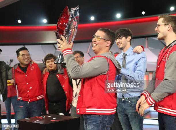 Player of the series Cody Altman holds the championship trophy at the League of Legends College Championship between Maryville University and the...