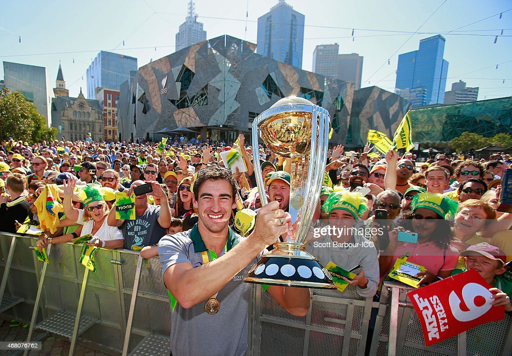Player of the Tournament, <a gi-track='captionPersonalityLinkClicked' href=/galleries/search?phrase=Mitchell+Starc&family=editorial&specificpeople=6475541 ng-click='$event.stopPropagation()'>Mitchell Starc</a> poses with the World Cup trophy and supporters during celebrations after winning the 2015 ICC Cricket World Cup Final at Federation Square on March 30, 2015 in Melbourne, Australia.
