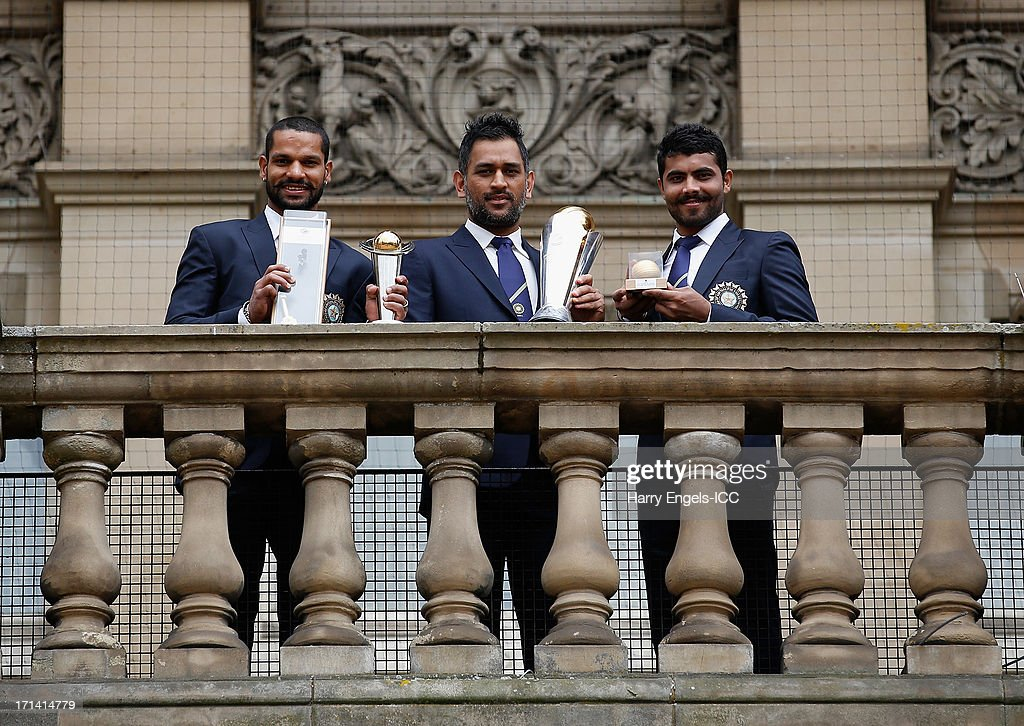 'Player of the Tournament' <a gi-track='captionPersonalityLinkClicked' href=/galleries/search?phrase=Shikhar+Dhawan&family=editorial&specificpeople=650580 ng-click='$event.stopPropagation()'>Shikhar Dhawan</a>, India captain MS Dhoni and 'Man of the Match' <a gi-track='captionPersonalityLinkClicked' href=/galleries/search?phrase=Ravindra+Jadeja&family=editorial&specificpeople=4880243 ng-click='$event.stopPropagation()'>Ravindra Jadeja</a> pose with their respective trophies during a photocall for the winners of the ICC Champions Trophy on June 24, 2013 in Birmingham, England.