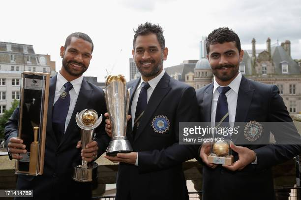 'Player of the Tournament' Shikhar Dhawan India captain MS Dhoni and 'Man of the Match' Ravindra Jadeja pose with their respective trophies during a...