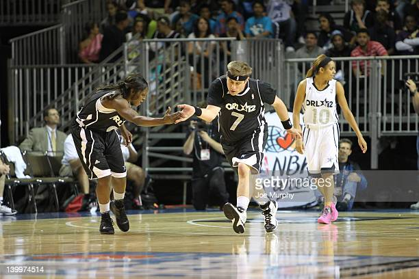 A player of the West team high five Marie FerdinandHarris of the Phoenix Mercury during the NBA Cares/Special Olympics Unity Sports Basketball Game...