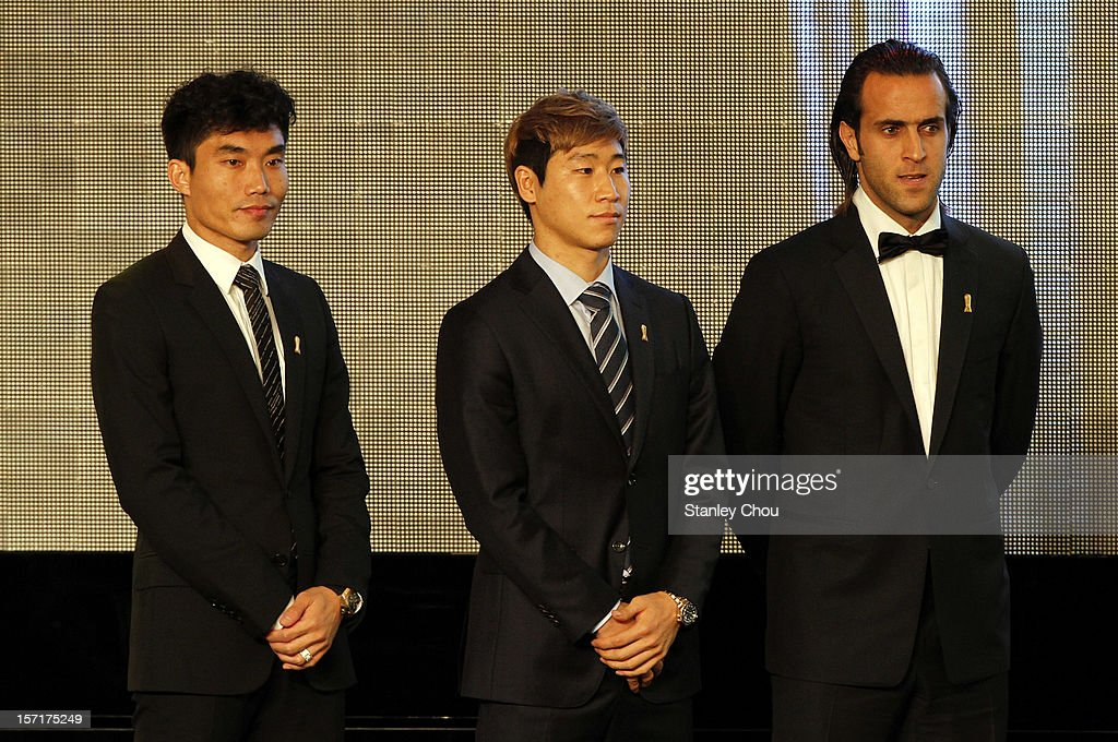 Player of the Year Nominees <a gi-track='captionPersonalityLinkClicked' href=/galleries/search?phrase=Zheng+Zhi&family=editorial&specificpeople=587776 ng-click='$event.stopPropagation()'>Zheng Zhi</a> (L) of China, Lee Keun Ho of South Korea and Mohammad <a gi-track='captionPersonalityLinkClicked' href=/galleries/search?phrase=Ali+Karimi+-+Soccer+Player+-+Born+1978&family=editorial&specificpeople=554731 ng-click='$event.stopPropagation()'>Ali Karimi</a> of Iran during the 2012 AFC Annual Awards at the Mandarin Oriental Hotel on November 29, 2012 in Kuala Lumpur, Malaysia.