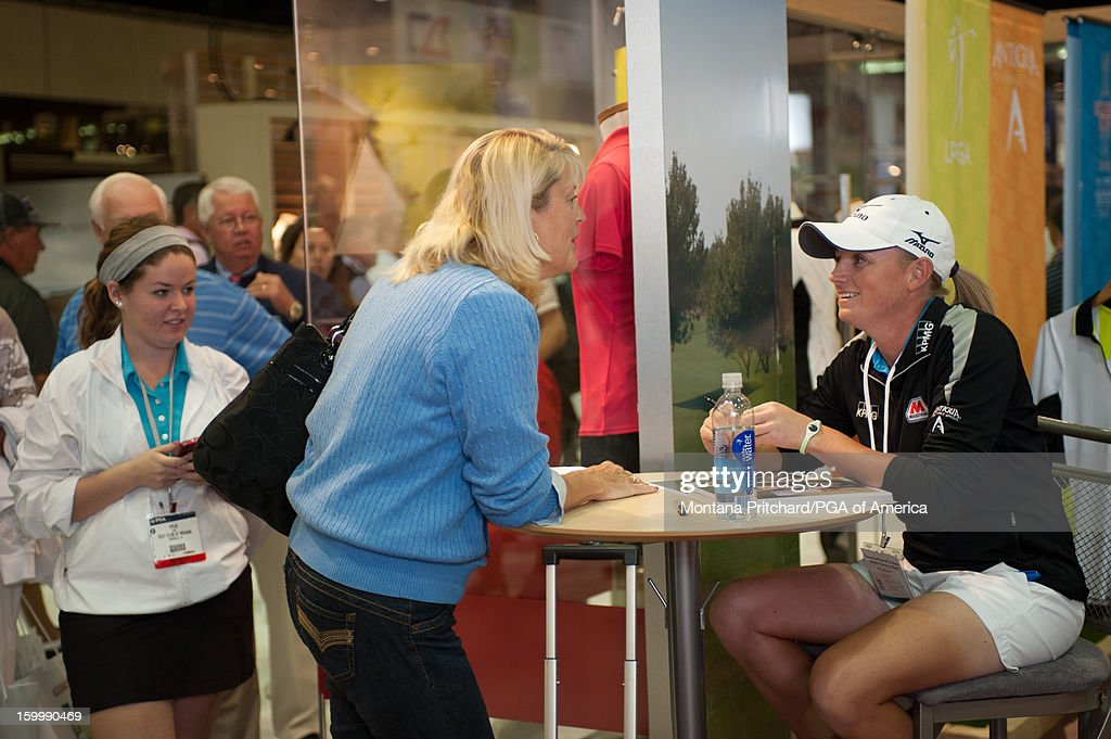 Player of the Year <a gi-track='captionPersonalityLinkClicked' href=/galleries/search?phrase=Stacy+Lewis&family=editorial&specificpeople=4217318 ng-click='$event.stopPropagation()'>Stacy Lewis</a> signs autographs for fans in the Antigua booth during the 60th PGA Merchandise Show on January 24, 2013 at The Orange County Convention Center in Orlando, Florida.