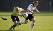 A player of Westfalen and a player of DFB U15 battle for the ball during the decision match between Rheinland and Mittelrhein during the Women's U17...
