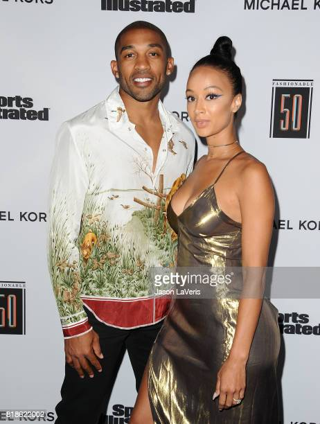 NFL player Orlando Scandrick and Draya Michele attend the Sports Illustrated Fashionable 50 event at Avenue on July 18 2017 in Los Angeles California