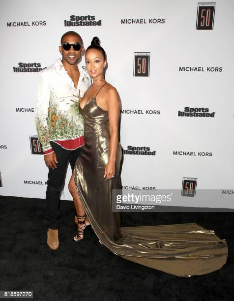 NFL player Orlando Scandrick and model Draya Michele attend Sports Illustrated Fashionable 50 at Avenue on July 18 2017 in Los Angeles California