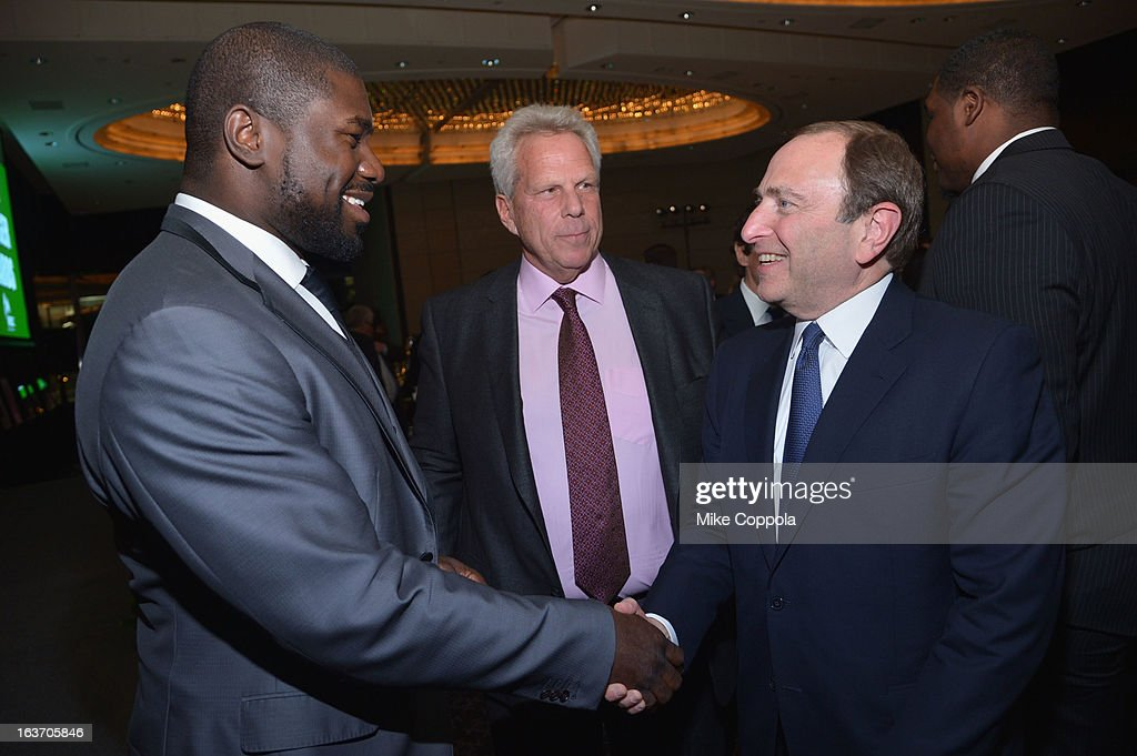 NFL player Ovie Mughelli, New York Giants chairman Steve Tisch, and NHL Commissioner Gary Bettman attend the 2013 Natural Resources Defense Council Game Changer Awards at the Mandarin Oriental Hotel on March 14, 2013 in New York City.