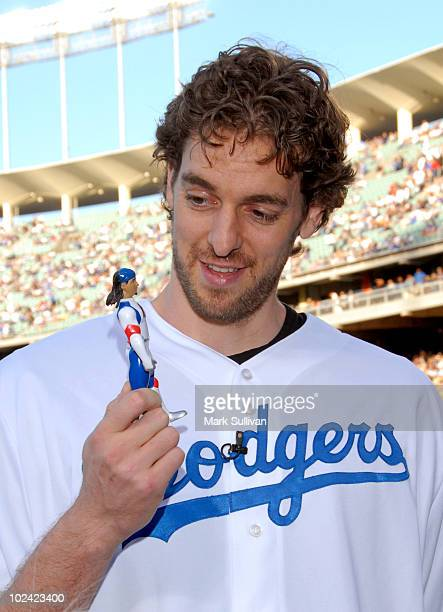 NBA player Pau Gasol with Manny Ramirez action figure at Dodger Stadium on June 25 2010 in Los Angeles California