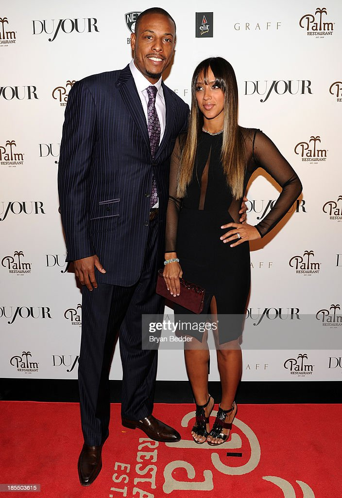 NBA player Paul Pierce (L) and Julie Pierce attend DuJour's Jason Binn's welcoming NY Nets Star Paul Pierce To NYC event on October 21, 2013 in New York City.