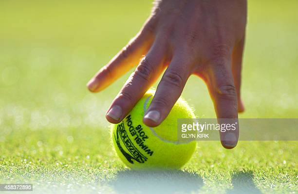 A player picks up a ball on the sixth day of the 2016 Wimbledon Championships at The All England Lawn Tennis Club in Wimbledon southwest London on...