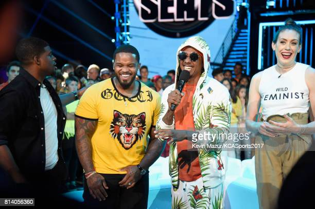 NHL player P K Subban MLB player Prince Fielder TV personality Nick Cannon and WNBA player Breanna Stewart participate in a competition during...