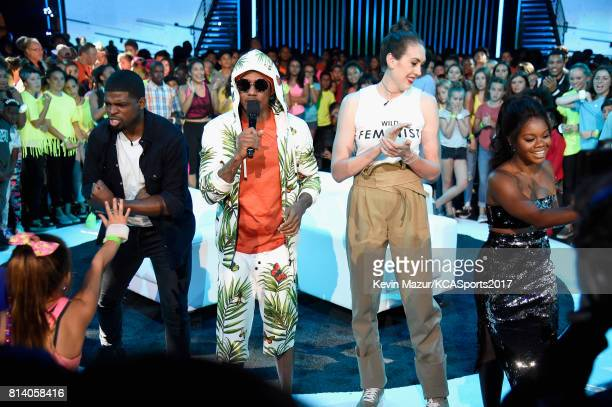 NHL player P K Subban TV personality Nick Cannon WNBA player Breanna Stewart and Olympic gymnast Gabby Douglas participate in a competition during...