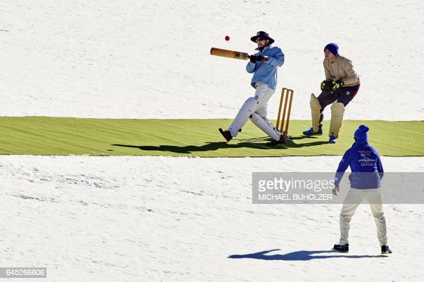 A player plays a shot during the 30th Cricket on Ice tournament held on the frozen surface of the Lake St Moritz on February 25 2017 The tournament...