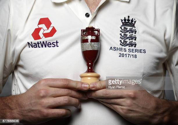 A player poses with a replica of the Ashes Urn during the 2017/18 England Ashes Squad portrait session at the Adelaide Oval on November 11 2017 in...