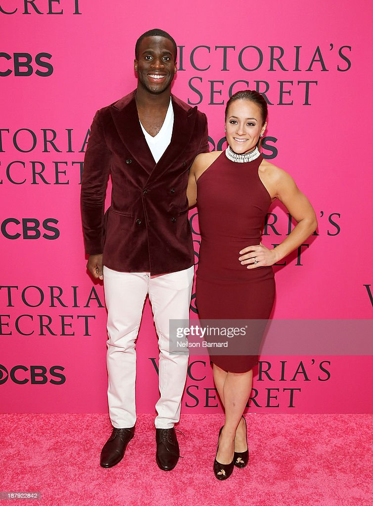 NFL player Prince Amukamara (L) and Pilar Davis attend the 2013 Victoria's Secret Fashion Show at Lexington Avenue Armory on November 13, 2013 in New York City.