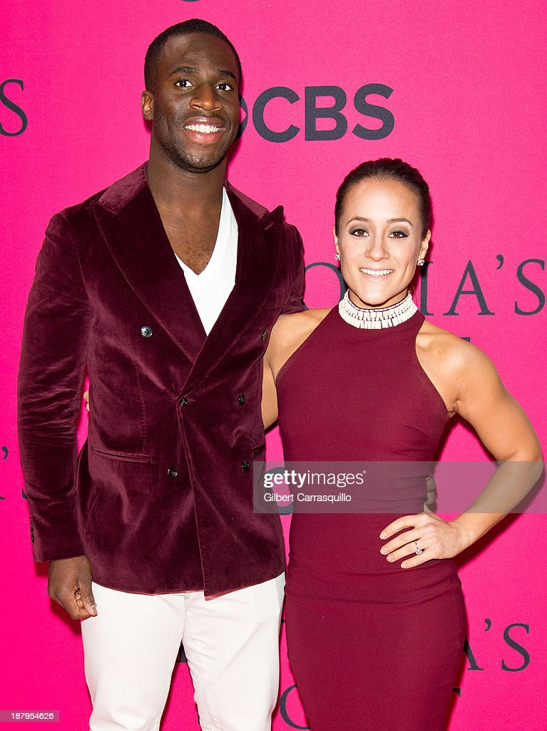 NFL player <a gi-track='captionPersonalityLinkClicked' href=/galleries/search?phrase=Prince+Amukamara&family=editorial&specificpeople=6357867 ng-click='$event.stopPropagation()'>Prince Amukamara</a> and Pilar Davis attend the 2013 Victoria's Secret Fashion Show at Lexington Avenue Armory on November 13, 2013 in New York City.