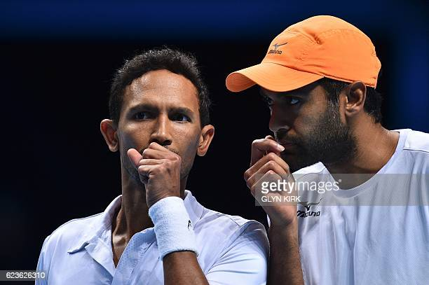 US player Rajeev Ram and his partner South Africa's Raven Klaasen talk between points against Australia's John Peers and his partner Finland's Henri...